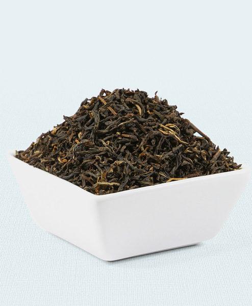 Schwarzer Tee China Golden Yunnan Bio in weißer Schale